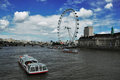 London eye a picture of the with some elements like the river thames and a boat Royalty Free Stock Photos