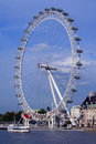 London eye by the river thames with ship and buildings Stock Photography