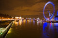 London eye seen from the bridge of big ben at night Royalty Free Stock Images