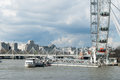 London eye and shell mex house golden jubilee bridge in the background Royalty Free Stock Photography