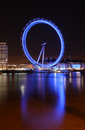 The London Eye viewed from the Thames at night Royalty Free Stock Images