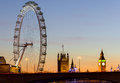 London eye and westminster at sunset uk january the big ben from the other side of waterloo bridge this popular landmark offers Stock Images