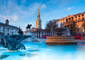 London fountain on the trafalgar square with st martin fields behind Royalty Free Stock Photos
