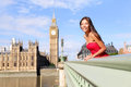 London happy woman by big ben in england beautiful tourist girl sightseeing travel on westminster bridge united Stock Photography