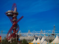 London olympics games arcelor mittal tower an olympic and olympic stadium against a blue sky Stock Images