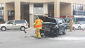 London ontario canada may firefighters respond to a two vehicle accident with one car destroyed in the middle of the street as Royalty Free Stock Images