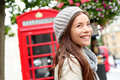 London people woman by red phone booth portrait of beautiful smiling happy young female casual professional business walking Royalty Free Stock Photography