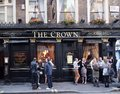 London pub one of the fondest traditions in england is to gather around the local on a warm summer evening Royalty Free Stock Photography