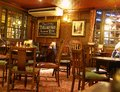 London pub traditional british interiors with wooden furniture and carpets Stock Images
