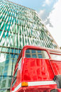 London red bus against modern skyline Royalty Free Stock Photo