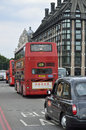 London Red Bus and old black cab in London Royalty Free Stock Photo