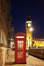London red phone booth telephone at night big ben in the distance is one of the most famous icons Stock Photo