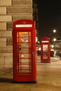London red phone booth telephone at night is one of the most famous icons Stock Photos