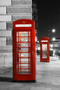 London red phone booth telephone at night is one of the most famous icons Royalty Free Stock Photography