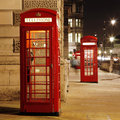 London red phone booth telephone at night is one of the most famous icons Stock Photo