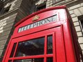 London red telephone booth famous is one of the most well known symbols of Royalty Free Stock Images