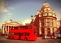 London retro style united kingdom typical red double decker bus with famous royal exchange building in background cross processed Royalty Free Stock Photo