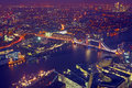 London rooftop view panorama at sunset with urban architectures and the tower bridge thames river night Royalty Free Stock Photography