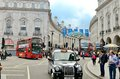 London scene red bus taxi cab people big ben luxury car Stock Photo