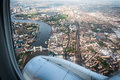 London from the sky view upon and famous tower bridge a landing plane Stock Images