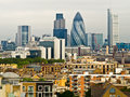 London skyline from a rooftop in south east the buildings include the gherkin st mary axe heron towers and tower Royalty Free Stock Photos