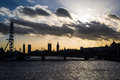 London skyline at sunset with The London Eye and Big Ben Royalty Free Stock Photo