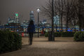 London skyline with an unrecognizable woman walking at night