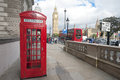 London street phone boot and big ben scene with red clock tower of westminster palace great britain Royalty Free Stock Photo