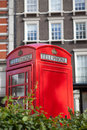 London symbol telephone box in residential area Royalty Free Stock Photos