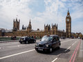 London taxi and the most famous landmark big ben united kingdom april is world s visited city as Royalty Free Stock Images