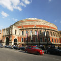 London taxi and royal albert hall uk may also called hackney carriage black cab in the background people cars present on Royalty Free Stock Photos
