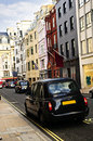 London taxi on shopping street Royalty Free Stock Image