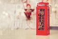 London telephone booth moneybox on wooden white table Royalty Free Stock Photo