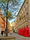 London telephone box an image of a side street in showing five of the retro red british telecom phone Royalty Free Stock Image