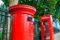 London telephone box red and post in street with historical architecture in Stock Images