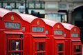 London telephone box red in street with historical architecture in Stock Image