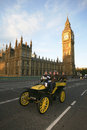 London to brighton veteran car run uk november participants passing westminster bridge big ben in the background event Royalty Free Stock Photos