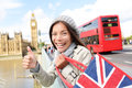 London tourist woman holding shopping bag big ben near showing thumbs up sign happy excited near shopper smiling on travel Stock Image