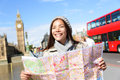 London tourist woman sightseeing holding map on europe travel by big ben and red double decker bus tourism people concept with Royalty Free Stock Photo