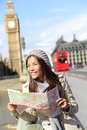 London tourist woman sightseeing holding map near big ben with red double decker bus tourism travel people concept with girl Royalty Free Stock Photos