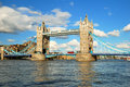 London Tower Bridge in evening light with white clouds Royalty Free Stock Photo