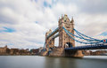 London tower bridge uk england is a combined bascule and suspension in over the river thames it is close to the of from Stock Images