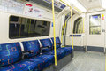 London uk april interior of empty northern line underground train showing access doors april in london Royalty Free Stock Photo