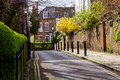 LONDON, UK - April, 13: Typical english street in spring with victorian houses in London Royalty Free Stock Photo