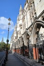 LONDON, UK - AUGUST 20, 2016: The Royal Courts of Justice from the Strand with details of the external columns and arcades Royalty Free Stock Photo