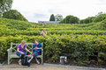 London uk august side view of people walking up shrubber shrubbery maze leading to the grounds kensington palace in kensington Royalty Free Stock Photos