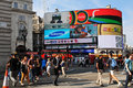 London uk august tourists walk in piccadilly circus major commercial area of home of important landmarks and shops Royalty Free Stock Image