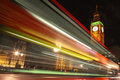London uk big ben at night and with bus light trails passing through Stock Photo
