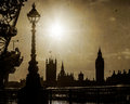 London uk houses of parliment in silhouette england view the and big ben taken from across the thames river with the eye the Royalty Free Stock Photo