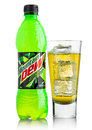 LONDON, UK - JUNE 9, 2017: Bottle and glass of Mountain Dew drink on ice isolated on white. Mountain Dew citrus-flavored soft Royalty Free Stock Photo